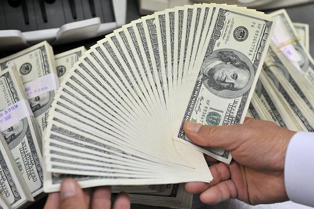 Đồng USD tăng mạnh trước cuộc họp của BOJ