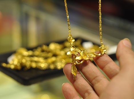 Giá vàng chiều 21/6/2013 vọt lên trên 1.300 USD/oz