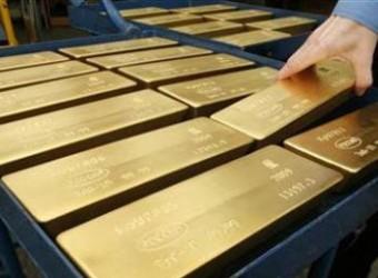 Giá vàng phiên châu Á giảm mạnh xuống 1.223 USD/oz