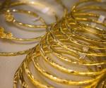Vàng trượt xuống gần ngưỡng 1.200 USD/oz do đồng USD và chứng khoán tăng mạnh