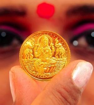 Đồng USD mạnh, nền kinh tế Trung Quốc suy yếu đặt vàng vào thế khó