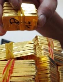 Vàng thế giới sáng 18/11 giảm trở lại gần mức thấp nhất trong vòng 6 năm qua