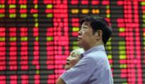 Chứng khoán Trung Quốc lao dốc hơn 7% trong ngày giao dịch đầu tiên của năm 2016